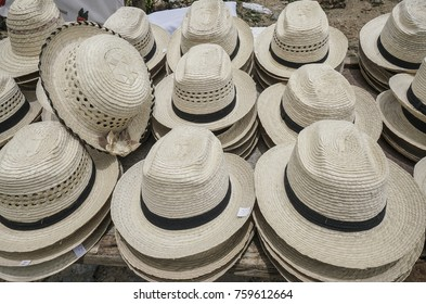 pile of straw hats