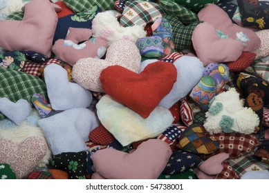 Pile of stuffed fabric hearts