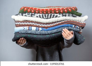 Pile of sweaters wearing knitted warm wool sweaters
