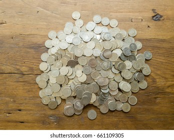 Pile of Swedish Krona (SEK) coins of Sweden. On wood table. Top view.