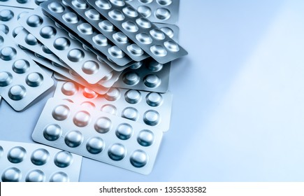 Pile of tablets pills in blister pack. Packaging in pharmaceutical industry. Pharmacy product. Drug selection to hospital. Global drug market concept. Pills management in healthcare provider.