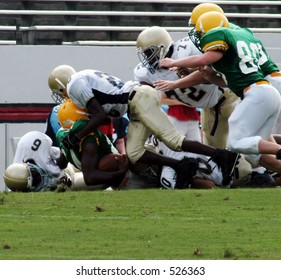 Pile up tackle in a football game