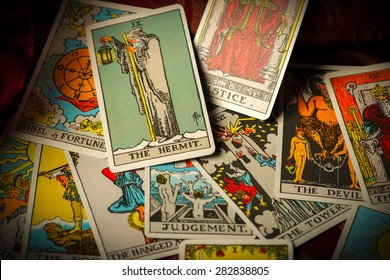 A pile of tarot trump cards jumbled, scattered and haphazardly arranged.