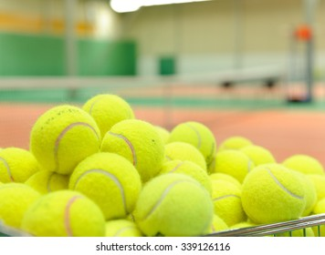 Pile of tennis balls in a basket