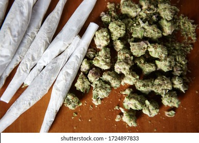 Pile of THC and CBD Marijuana bud with Joints