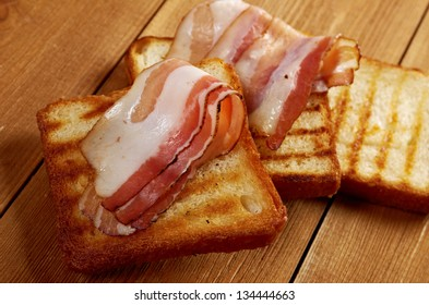 pile  toasted bread slices for bacon.Close up of toasted white bread in slices