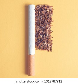A pile of tobacco with a cigarette on a yellow background. Top view. Toned. square format