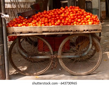 Pile of Tomatoes on a cart - Fruit Market in Delhi, India