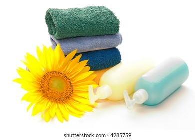 pile of towels, sunflower and liquid soap