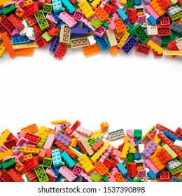 Pile toy colored plastic blocks on white background