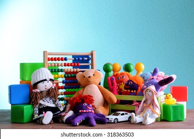 Pile of toys on blue background