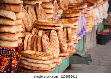 Pile of a traditional central asian round and flat bread, baked at tandoori oven, selling at  Bazaar in Bishkek, Kyrgyzstan