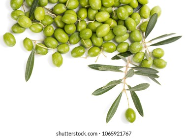 Pile and twig of fresh green olives with leaves isolated on white background, top view.