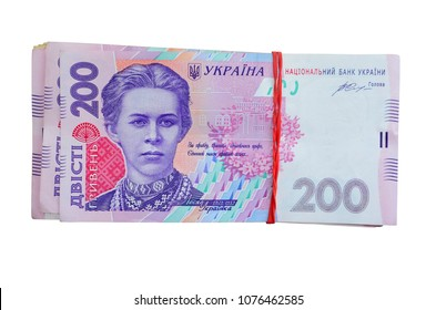 A pile of ukrainian money on a two hundred hryvnia isolated on white background. Top view