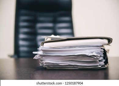 Pile of unfinished documents on office desk, Stack of business paper. A file folders  with documents and important documents.