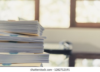 Pile of unfinished documents on office desk, Stack of business paper,Stack of documents placed on a business desk in a business office.