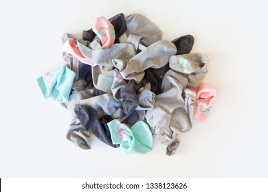 Pile of unsorted dirty socks. Messed up socks. White background.