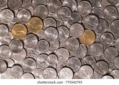 A pile of  US coins, America states 25 cents quarters and dollars