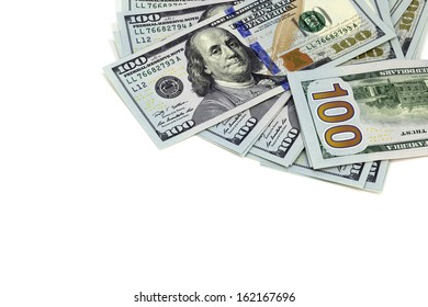 Pile of US Currency on White Background with Copy Space.