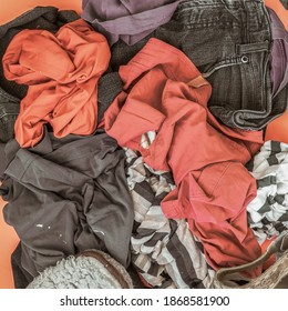 Pile of used clothes. Disposal, second hand, recycling concept