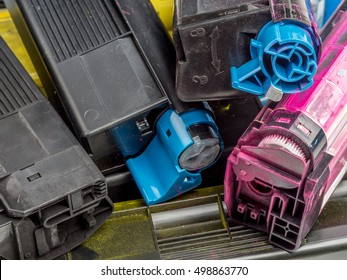 Pile of used color laser printer toner cartridges