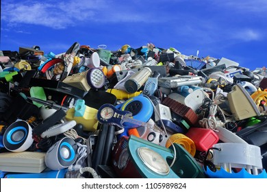 Pile of used Electronic and Housewares Waste Division broken or damage with blue sky and clouds background,  for Reuse and Recycle concept.