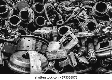 Pile of Used machine parts are oily and rusty in second hand machinery shop, Black and White
