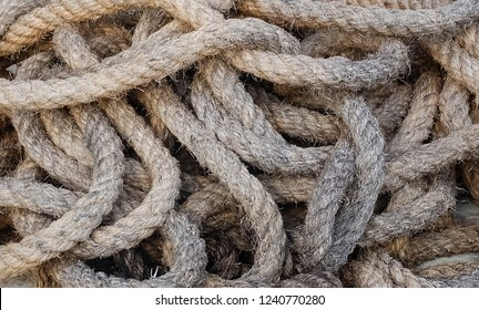 Pile of Used Natural Brown Rope Made From Dried Straw, Eichhornia Crassipes or Water Hyacinth Plants.