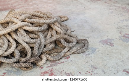 Pile of Used Natural Brown Rope Made From Dried Straw, Eichhornia Crassipes or Water Hyacinth Plants on Cement Floor.