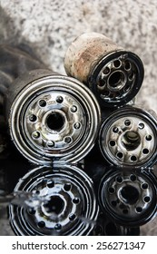 Pile of used oil filter of a car engine