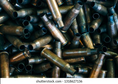 pile of used rifle cartridges 7.62 mm caliber, many empty bullet shells, assault rifle bullet shell, military background, top view