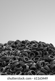 pile of used rubber tyres isolated on gray background high resolution - clean composition