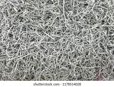 A pile of used staples. Old staple needle in use. White background.