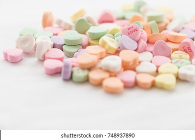 A pile of Valentine conversation candy hearts featuring the phrase My Love