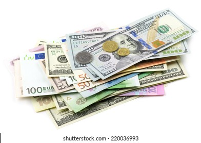 Pile of various currencies isolated on white background.