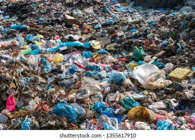 Pile of various domestic garbage in landfill