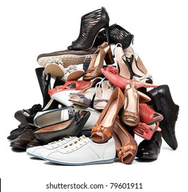 Pile of various female and male shoes over white background