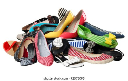 Pile of various female summer shoes isolated over white, with clipping path