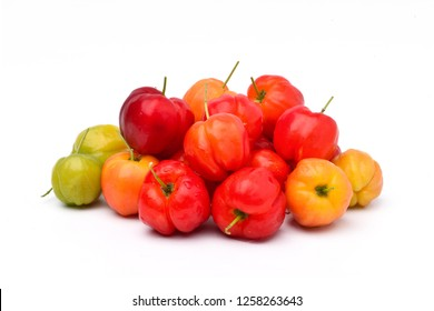 Pile of various organic Acerola cherry  isolated on white background