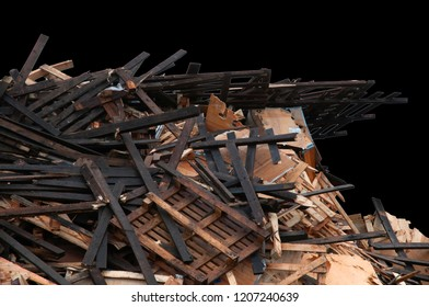 Pile of various pieces of discarded wood on a black background