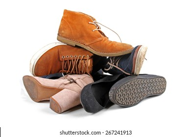 pile of various shoes isolated on white background