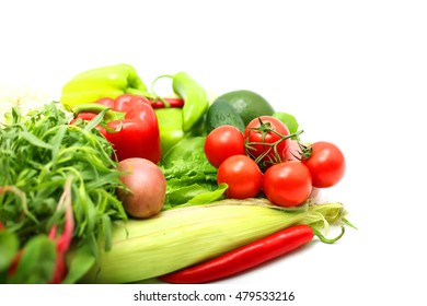 Pile of vegetables isolated on white background with copy space
