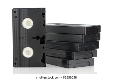 Pile of videotapes on  white reflective background.