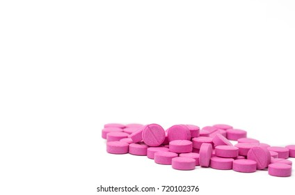 Pile of warfarin pink tablet pills on white background. Warfarin for treatment deep vein thrombosis. Anticoagulant medicine. Pharmacy drug store product. Pharmaceutical industry. Anticoagulation.