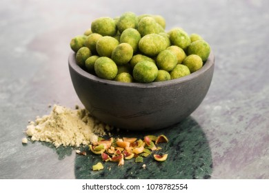 Pile of wasabi coated peanuts in bowl
