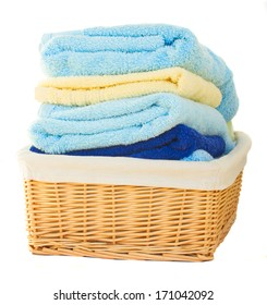 Pile of washed towel in basket  isolated on white background