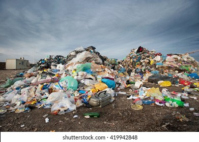 Pile of waste at city landfill. Waste management, ecology concept