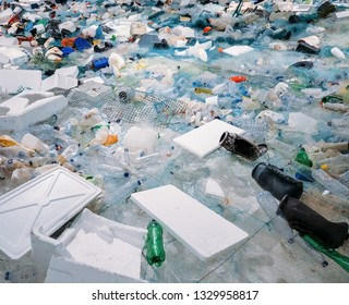 Pile of waste plastic bottles and other trash