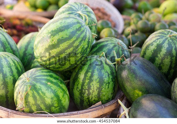 A pile if watermelons at the market