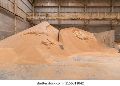 Pile of wheat bran, raw material storage, storage of raw materials. animal feed industry, animal feed factory.